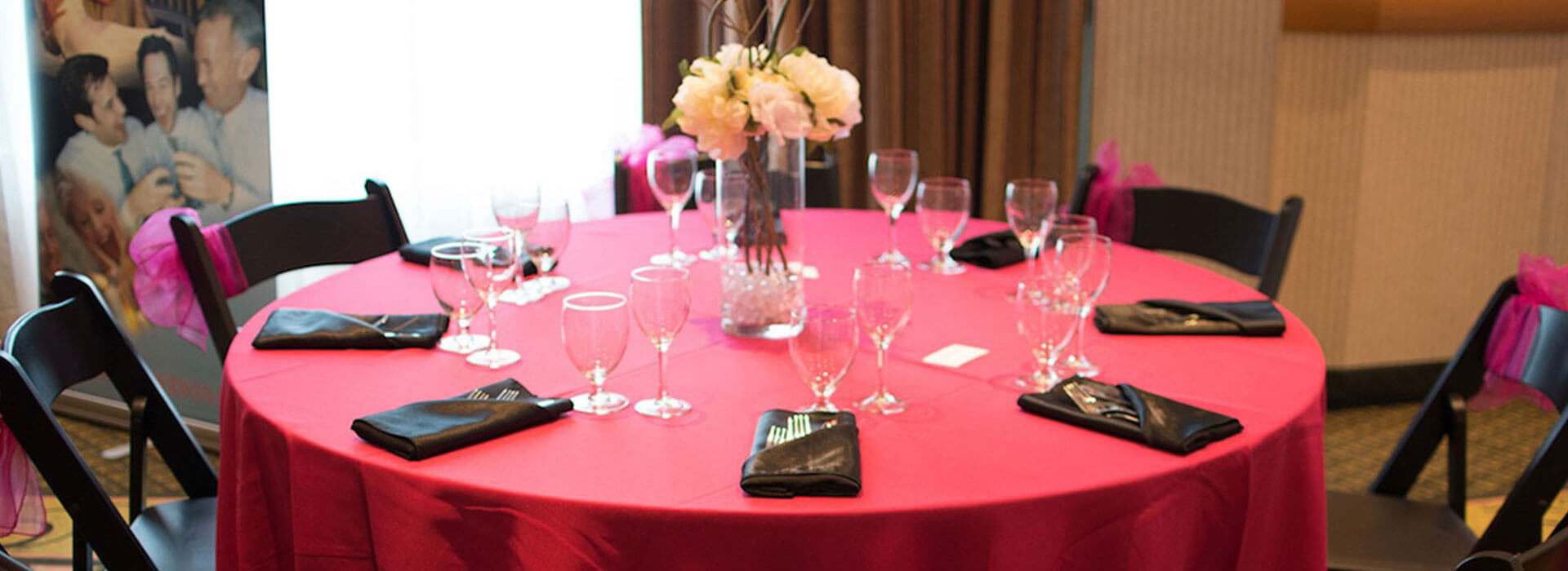 Elegant table with red table cloth, wine glasses and flowers at Holiday Inn North Vancouver