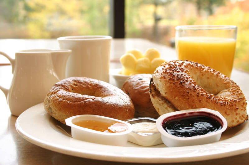 Breakfast is served with bagels, condiments and juice