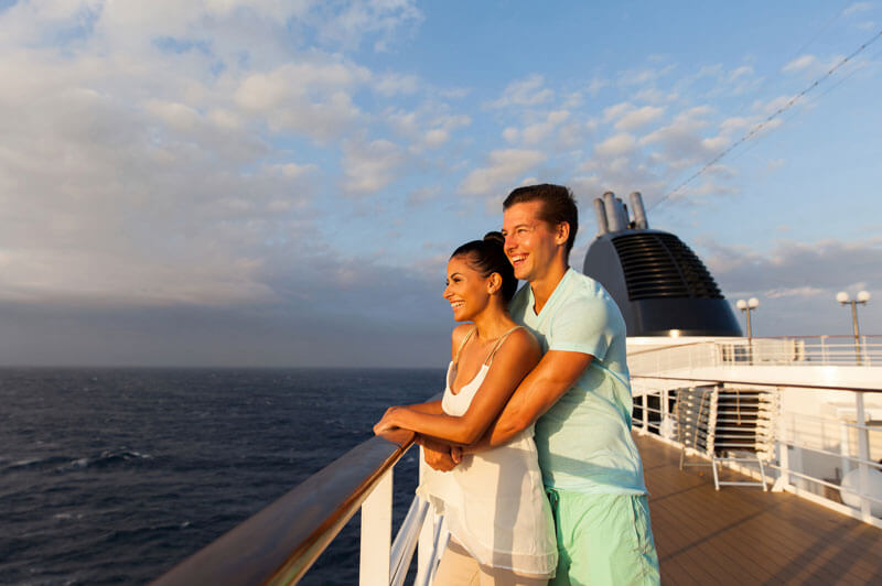 A couple on a cruise looking out into the ocean