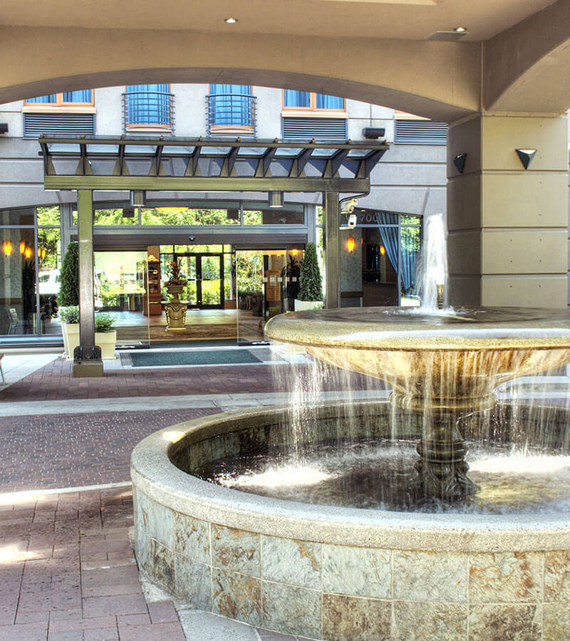 A glistening water fountain welcomes visitors to the Holiday Inn North Vancouver