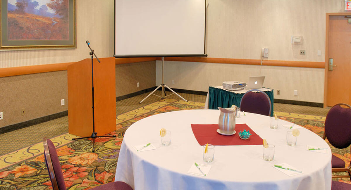 Speaker's podium and screen set up in the meeting room at Holiday Inn North Vancouver