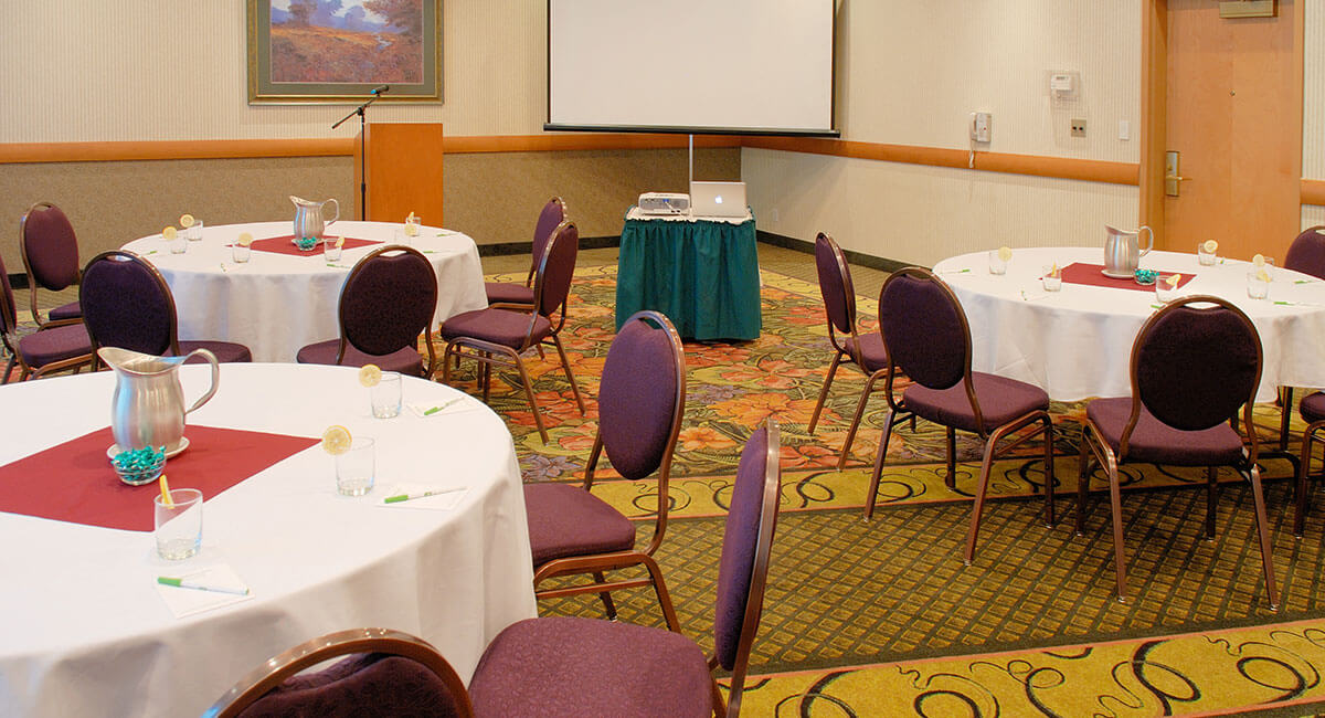 Meeting room set up for speakers and visual presentation at the Holiday Inn North Vancouver