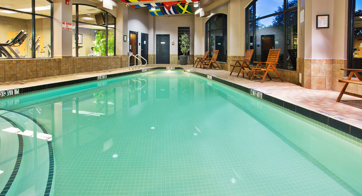 Heated indoor swimming pool with crystal clear waters at the Holiday Inn North Vancouver
