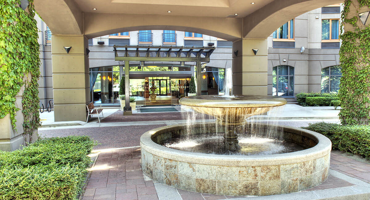 A water fountain greets visitors and guests at the front entrance to the Holiday Inn North Vancouver