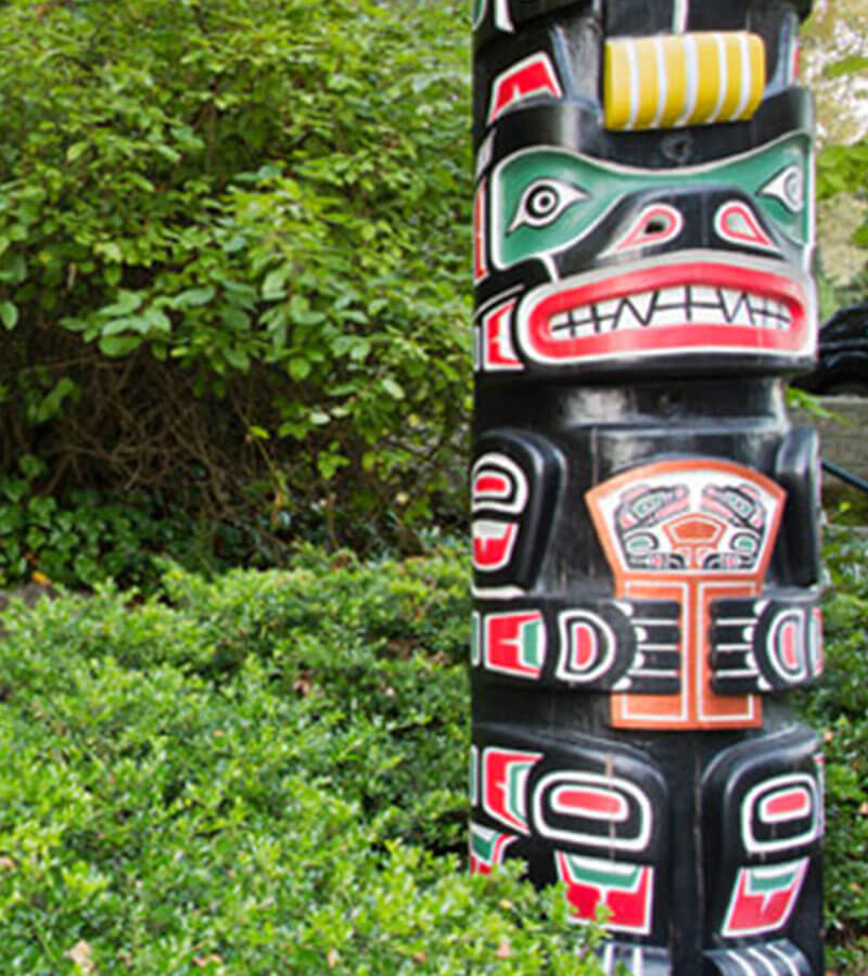 Native art set against the green scenery of nature