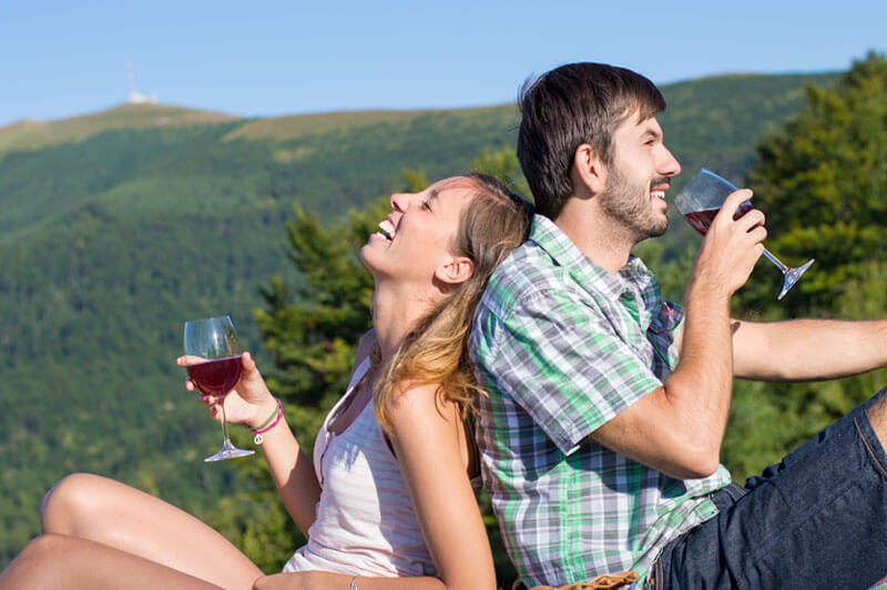 Two people enjoying wine and a romantic getaway among the mountains in North Vancouver
